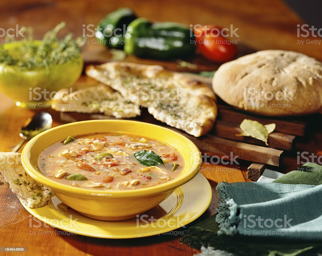 Rustic Italian soup with bread stock photo