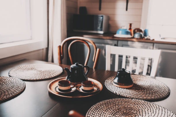 rustic kitchen in brown and grey tones in modern farmhouse ot cottage. Morning coffee on wooden table stock photo
