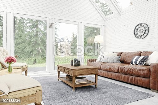 Living room of a chalet with forest and mountain view.