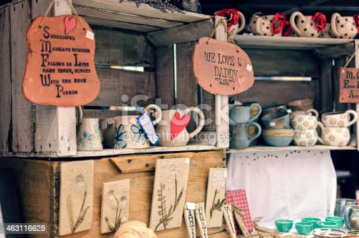 A rustic market stall in England offer handmade crafts and pottery.