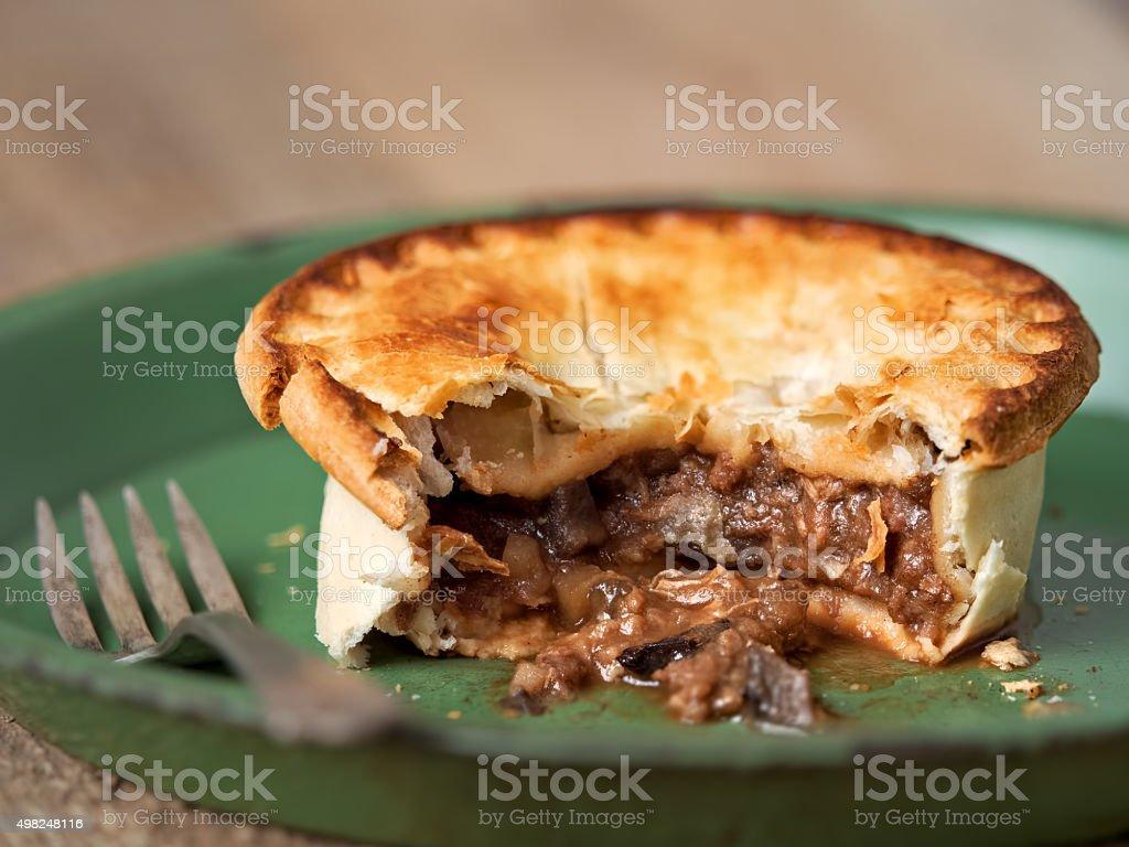 rustic meat and mushroom pie stock photo
