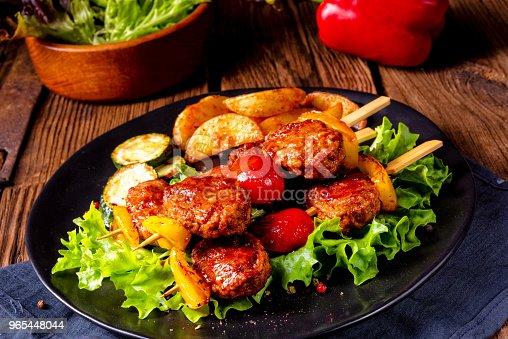 Rustic Meatballs Skewers Of Tomato Paprika And Baked Potato Quarters - zdjęcia stockowe i więcej obrazów Barbecue