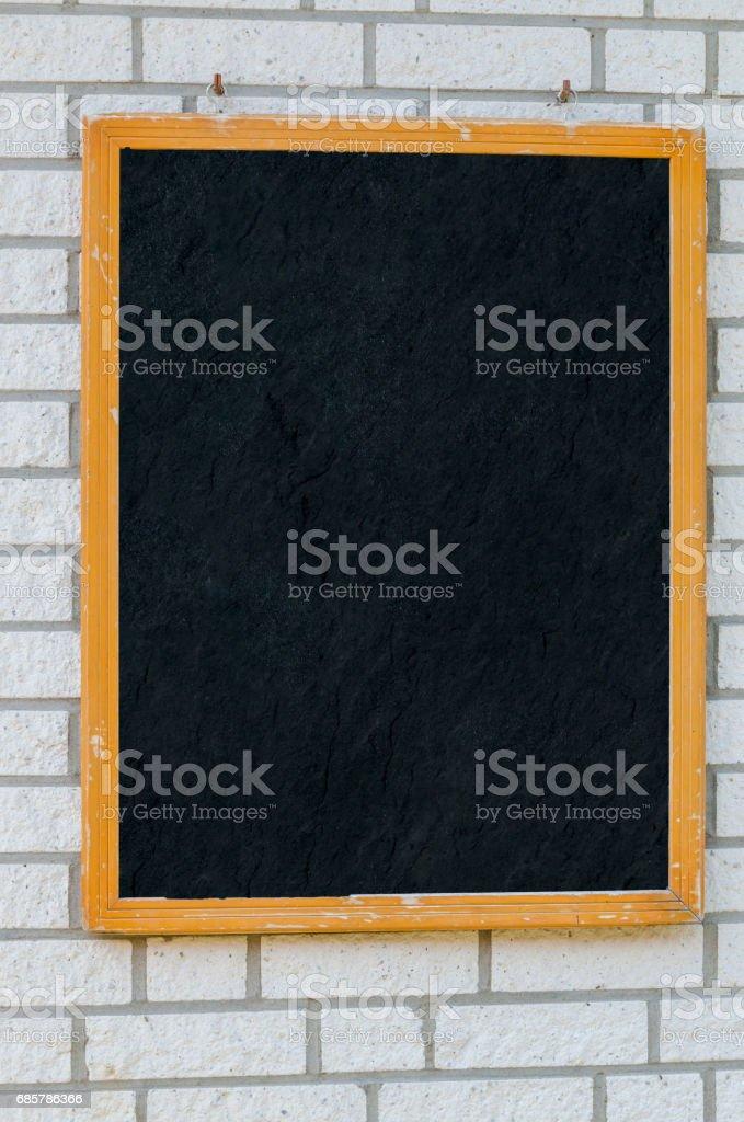 Rustic Menu Board On A Stone Wall Royalty Free Stock Photo
