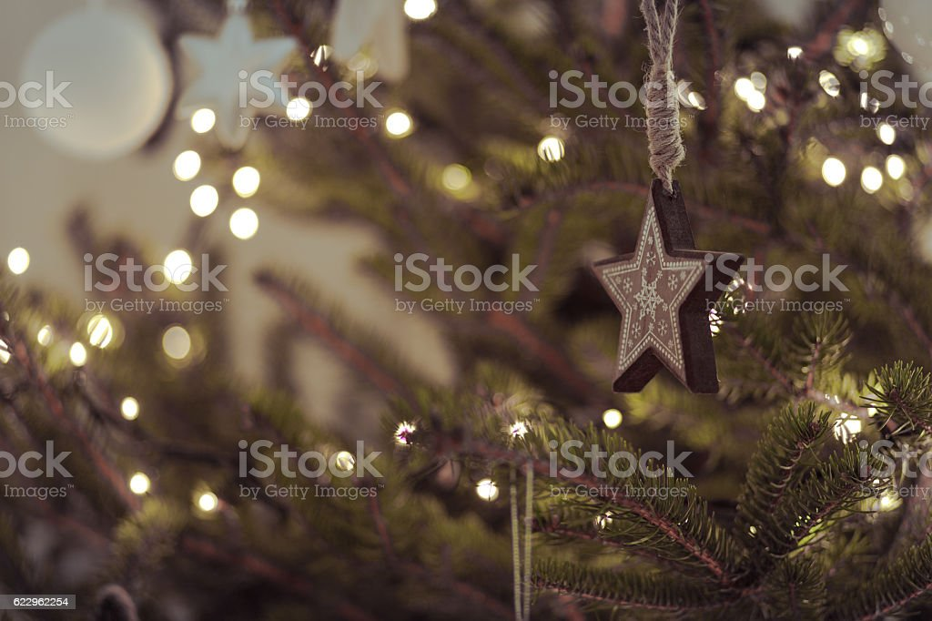 Rustic modern christmas decoration star hanging on a natural pine stock photo