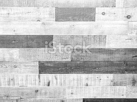 A full frame monochrome gray, black and white wood grain boards background made with old rough textured knotted wood timber.