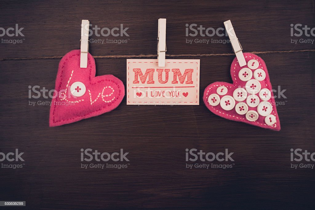 Rustic Mother's Day message with handmade hearts stock photo