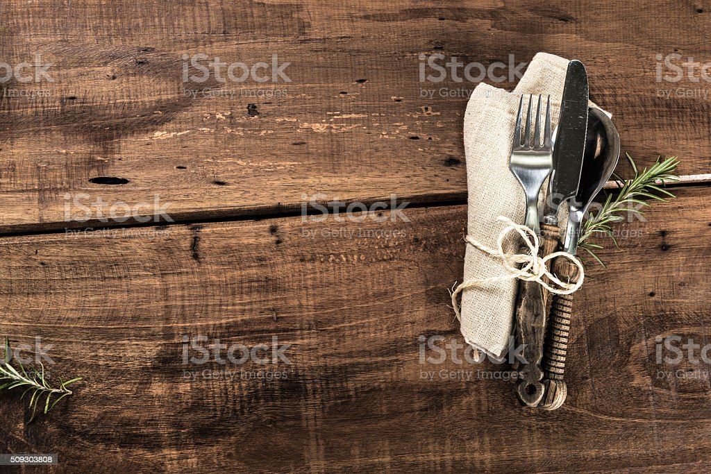Rustic Old Wooden Table With Cutlery anc Copy Space stock photo