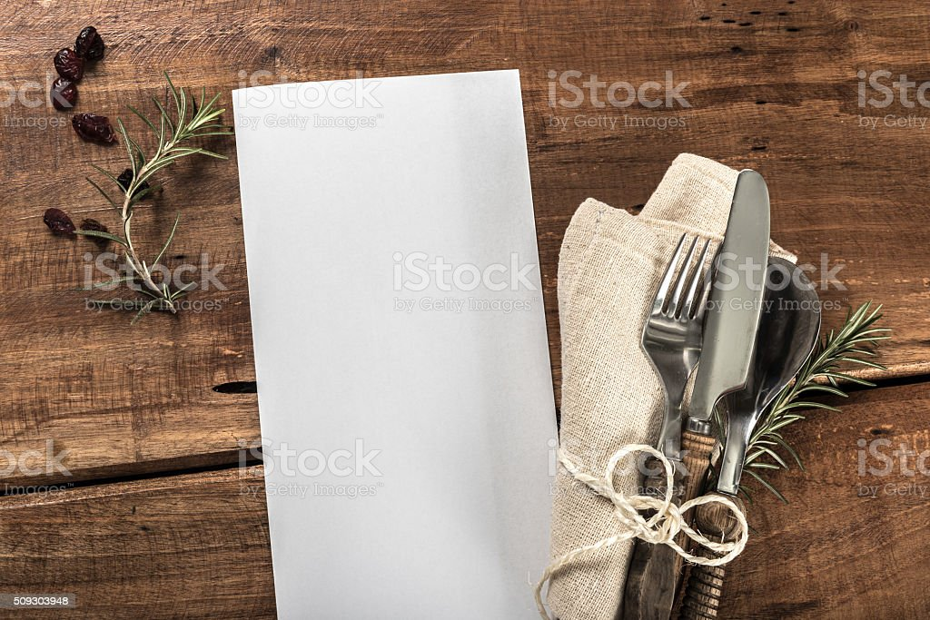 Rustic Old Wooden Table With Cutlery and Empty Meny Copyspace stock photo