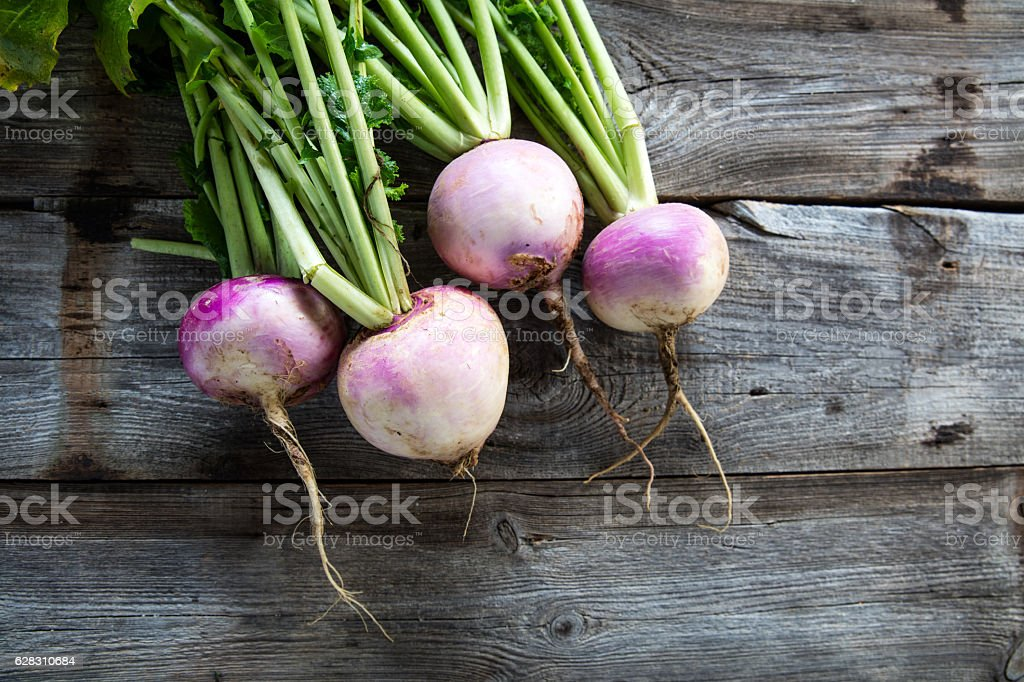 rustic organic turnips on genuine wood background for vegetarian food stock photo