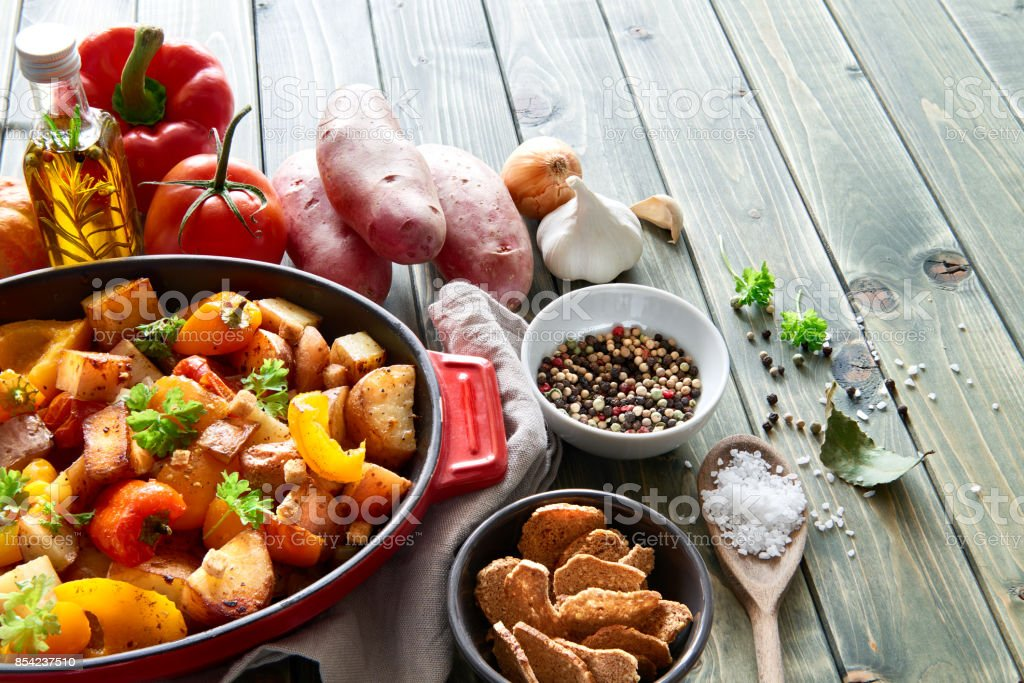 Rustic, oven baked vegetables with spices and herbs in baking dish stock photo
