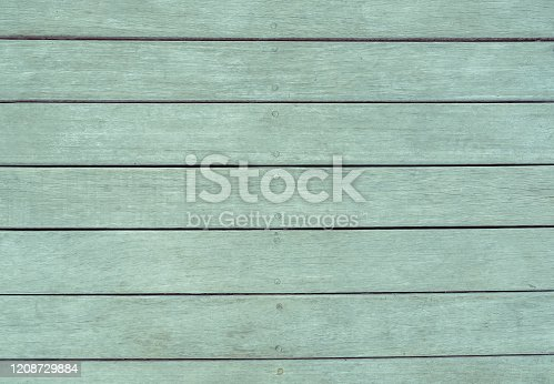 Close up shot details of rustic wood texture in green pastel color