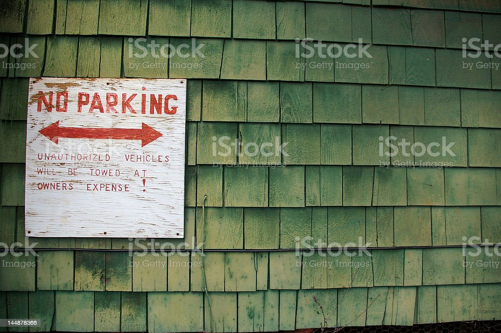 Rustic Patina Green Wood Shingle Siding With No Parking Sign stock photo