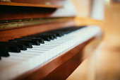 Rustic piano keys, close up picture. Classical instrument.