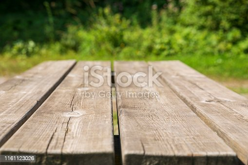 Rustic pine Picnic table. Untouched nature,  meadow grass in the background.