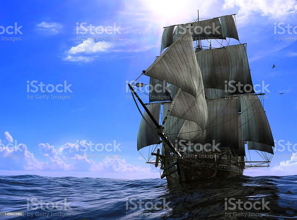 Rustic pirate ship on the blue ocean waters  stock photo