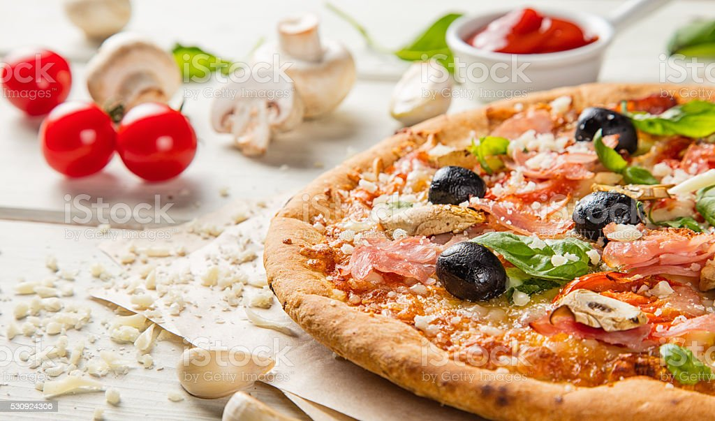 Rustic pizza with ingredients, top view stock photo