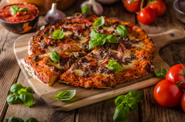 Rustic pizza with minced meat stock photo