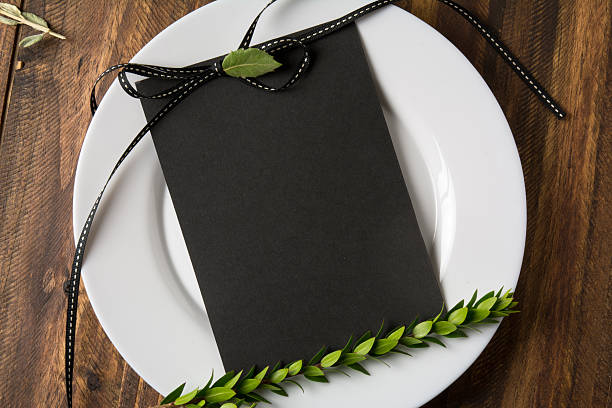 Rustic place setting with empty menu stock photo