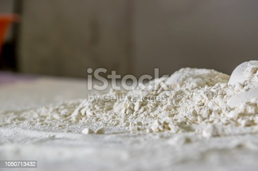 Traditional kitchen counter covered with flour ready to do some dough.