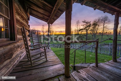 Beautiful evening light seen from the front porch of an old rustic cabin in the Cumberland Gap National Park.