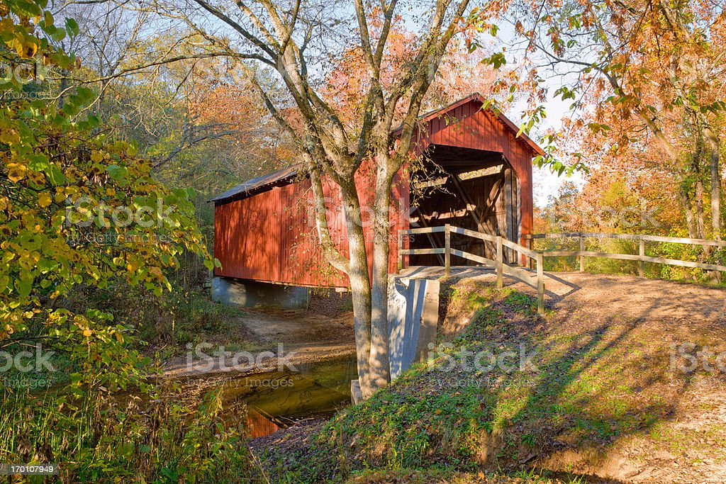 rustic red covered bridge - autumn stock photo