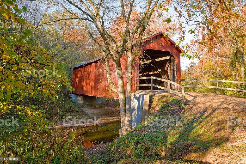 rustic red covered bridge - autumn stock photo