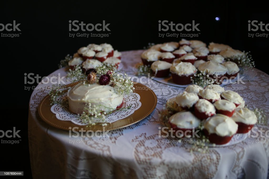 Red Velvet Wedding Cake.Rustic Red Velvet Wedding Cake And Cupcakes With Cream Cheese Frosting On A Gold Charger With A Doily Decorated With Dried Maroon And Pink Fall