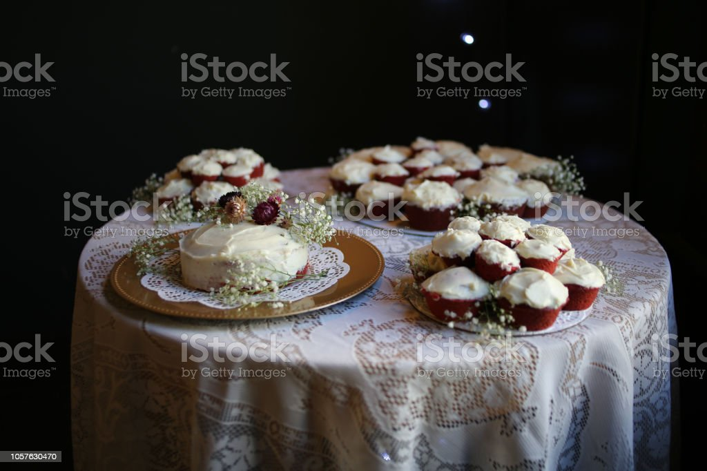 Red Velvet Wedding Cake.Rustic Red Velvet Wedding Cake And Cupcakes With Cream