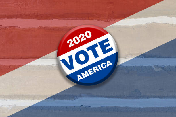 rustic red white blue vote 2020 america button pin on wood background featuring tilted gradient over faded stripes painted over wooden boards used as invitation card sign poster board stock photo