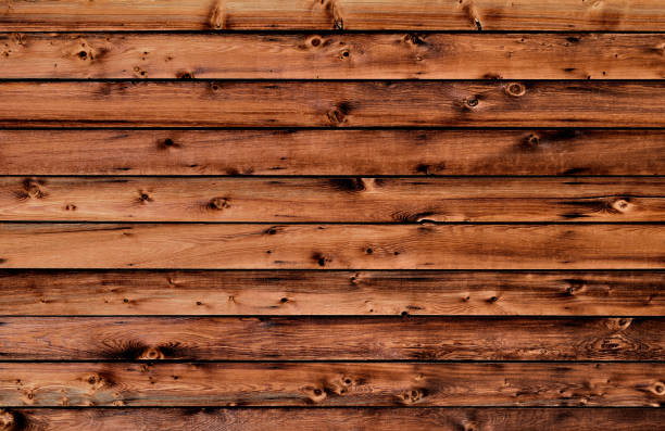 rustic red woodgrain western boards abstract background - knotted wood stock pictures, royalty-free photos & images