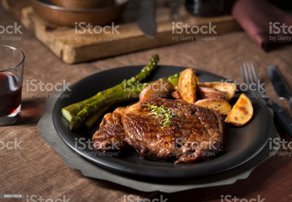 Rustic Ribeye Steak Dinner stock photo