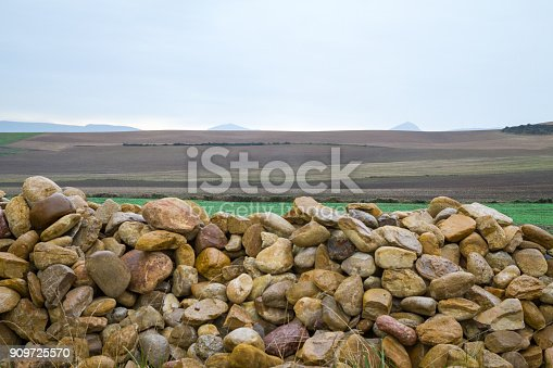 On an overcast day this is mainly a photo of rocks cobbled together in Spain on the Camino Santiago