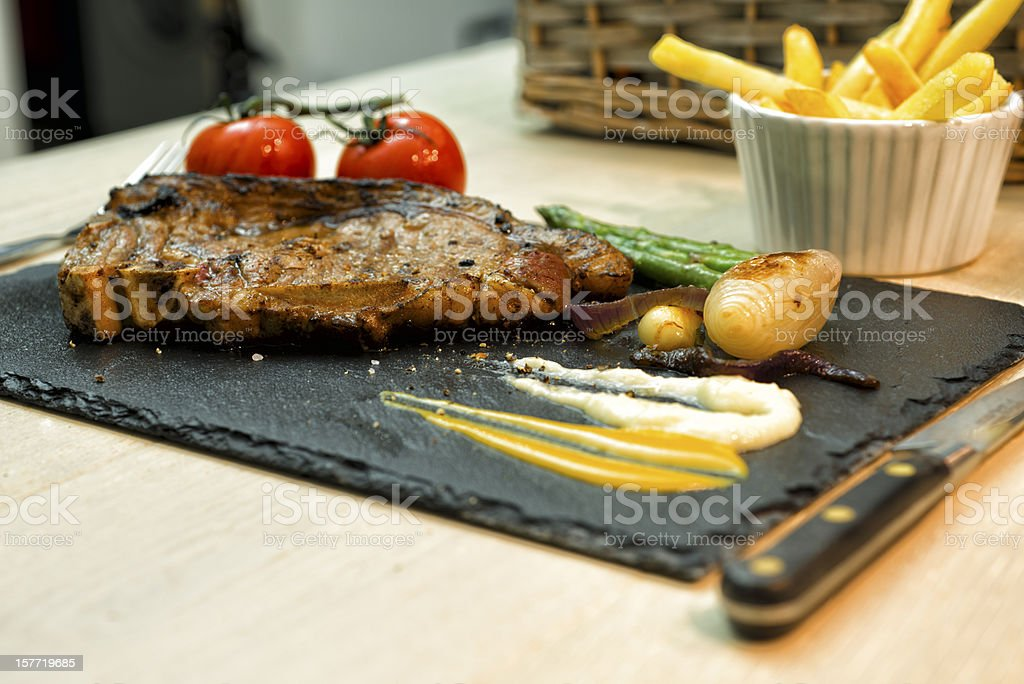 Rustic Rump Steak and French fries on Slate Plate stock photo