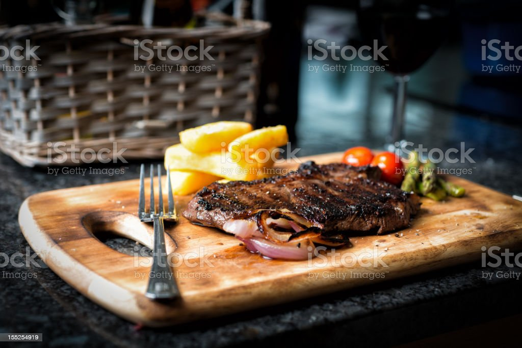 Rustic Rump Steak and French fries stock photo