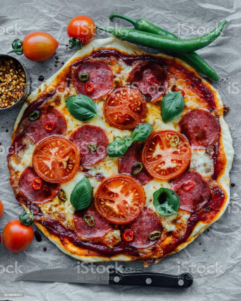 rustic salami pizza stock photo