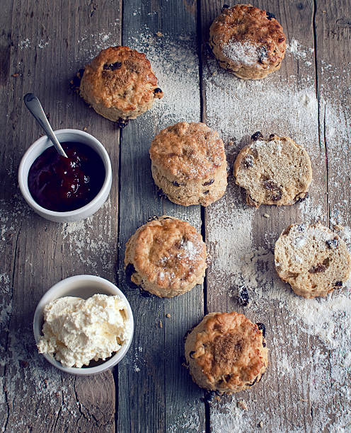 rustic scones with jam and cream - scone bildbanksfoton och bilder