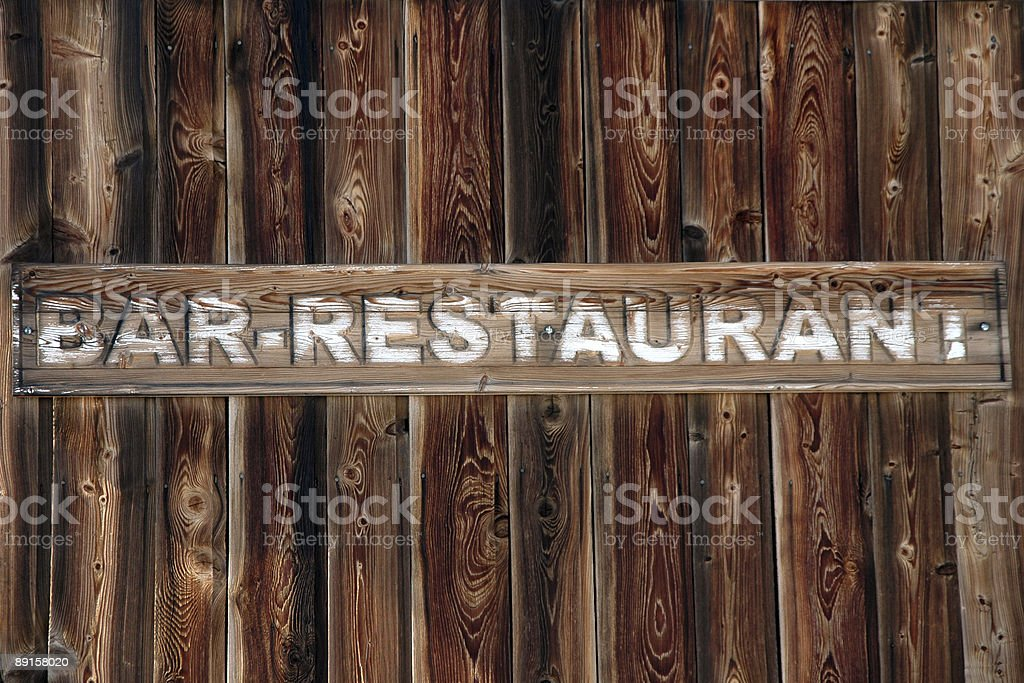 rustic sign for a bar and restaurant royalty-free stock photo