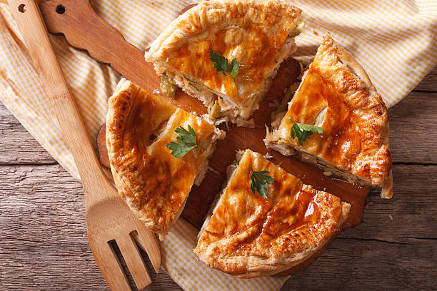 Rustic sliced chicken pie close-up on the table. horizontal top stock photo