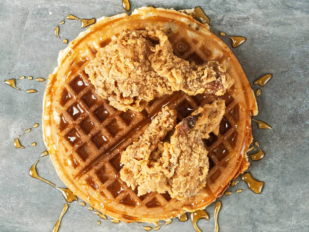 rustic southern american comfort food chicken waffle close up of rustic southern american comfort food chicken waffle waffle stock pictures, royalty-free photos & images