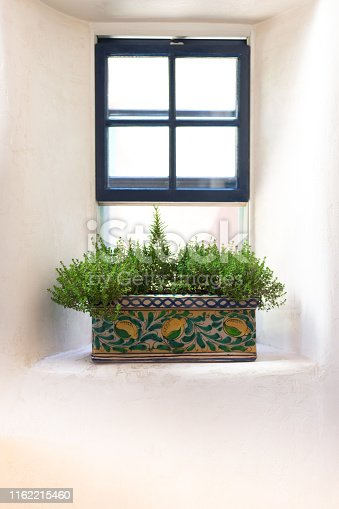 Rustic Southwest USA Kitchen: Window with herb container. Shot in Santa Fe, NM.