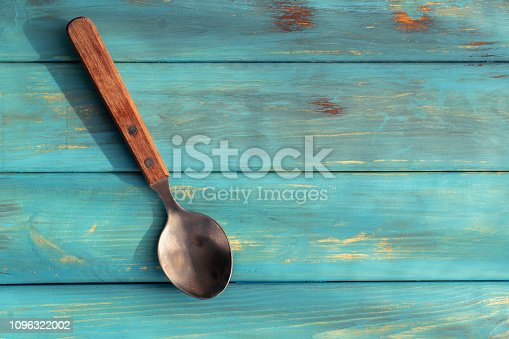 rustic spoon on wooden table