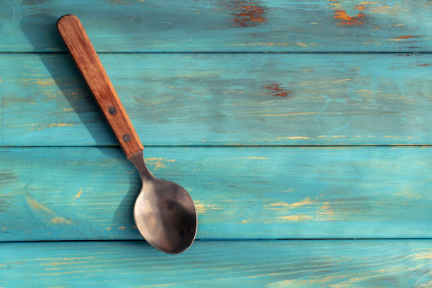 rustic spoon on wooden table stock photo