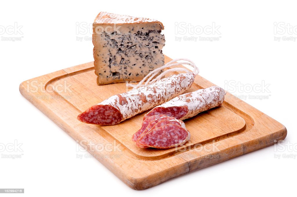 Rustic still life with cutting board, smoked sausage, and mature royalty-free stock photo