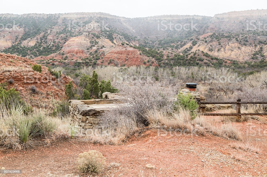 Rustic Stone Cabin in Rugged Terrain stock photo
