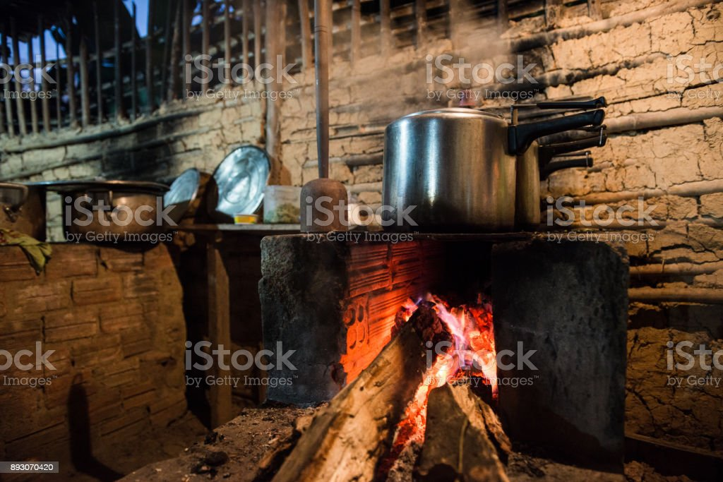Rustic stove, cooking with wood stove stock photo