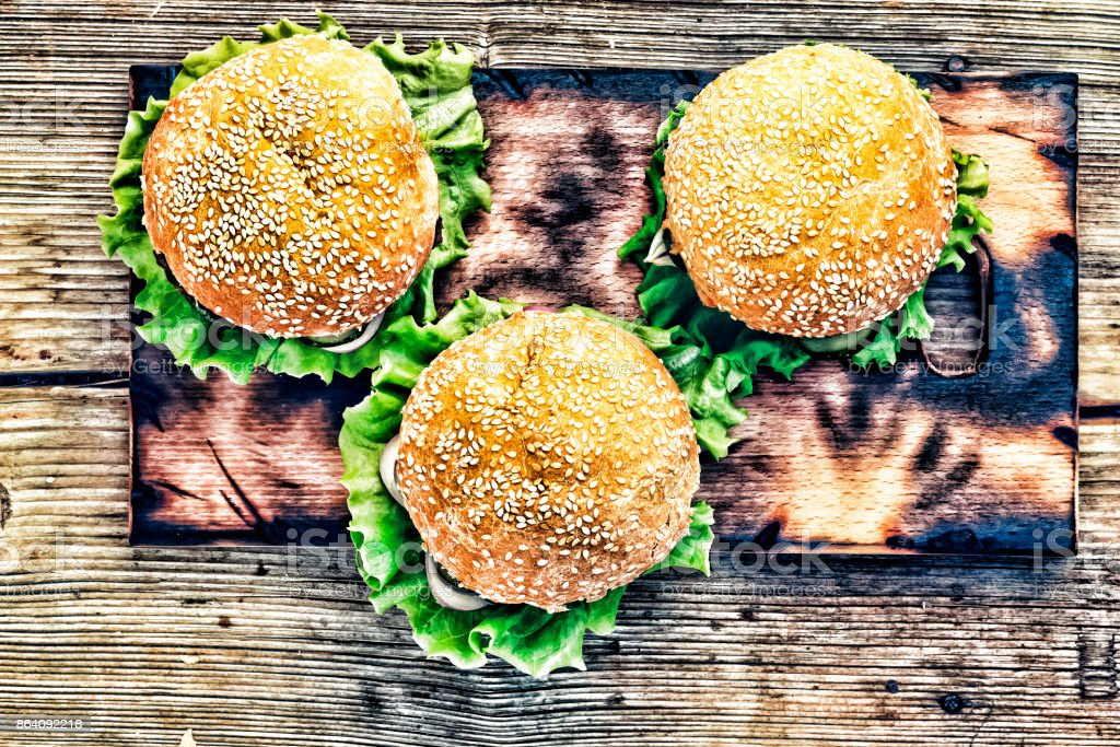 Rustic style, top view. Hamburger on a wooden table. royalty-free stock photo