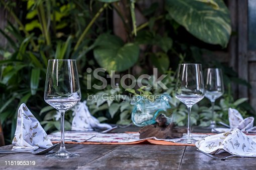 Rustic table set up. Vintage table arrangment on old wooden background in restaurant