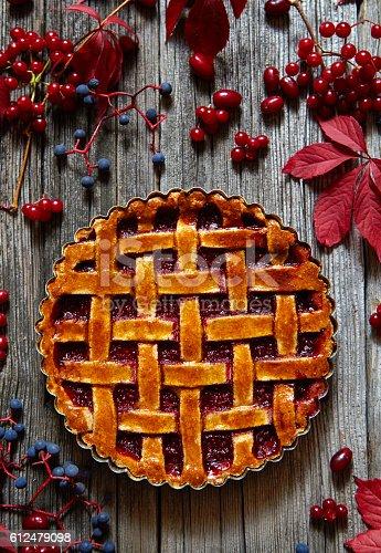 istock Rustic Thanksgiving american raspberry pie preparation with jam and raspberries 612479098