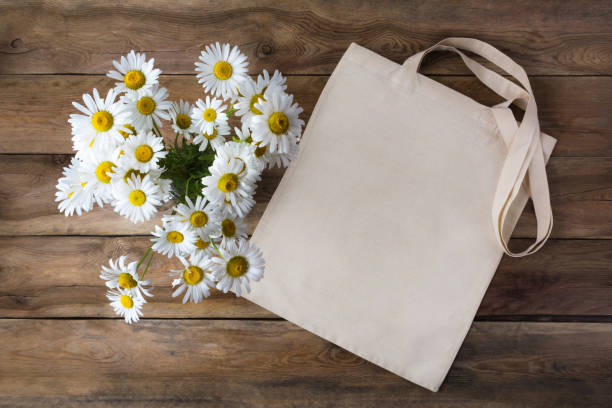 Rustic tote bag mockup with daisy stock photo