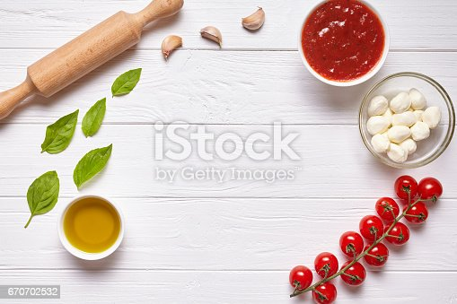 1136817041 istock photo Rustic traditional Italian food background with empty copy design space on white wooden texture kitchen table 670702532